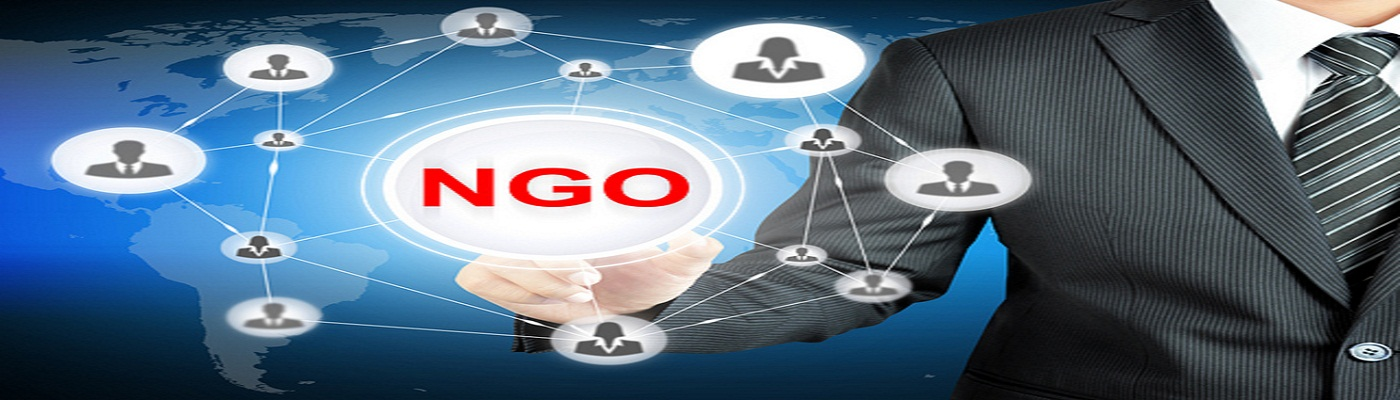 Businessman pointing on NGO (Non-Governmental Organization) sign on virtual screen with people icons linked as network